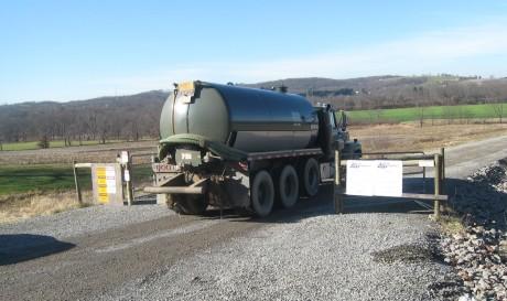 A tanker heads for a frack pond near Evans City, PA.